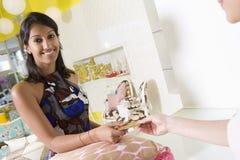 Woman Purchasing Cushion At Shop Royalty Free Stock Photography