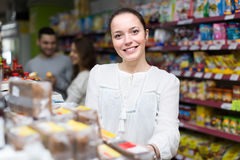 Woman purchasing food Royalty Free Stock Images