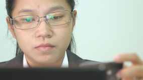 Woman purchasing on line with her laptop stock video
