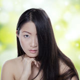 Woman with pure skin and black hair Stock Image