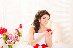 Woman purity concept. Bride's hands holding red apple - symbol of love. Stock Image