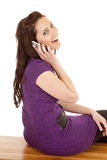 Woman in purple back on phone smile Royalty Free Stock Images