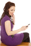 Woman in purple back smirk phone Royalty Free Stock Photos