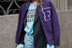 Woman with purple baseball jacket before Angelo Marani fashion show, Milan Fashion Week street style on