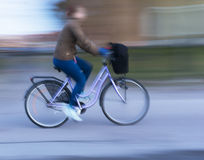 Woman on purple bike Stock Photography