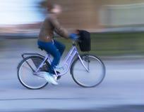 Woman on purple bike Stock Photography