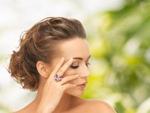 Woman with purple cocktail ring Stock Photos