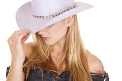Woman purple cowgirl hat close touch Royalty Free Stock Photo