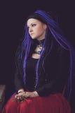 Woman with purple dreadlocks Stock Images