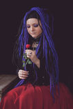 Woman with purple dreadlocks Royalty Free Stock Photography