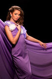 Woman in the purple dress Stock Image
