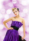 Woman in purple dress Royalty Free Stock Image