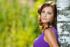 Woman in purple dress is based on Royalty Free Stock Photography