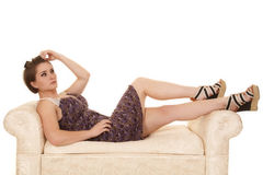 Woman purple dress lace shoulders lay bench Royalty Free Stock Photo