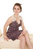 Woman purple dress lace shoulders sit look side Stock Image