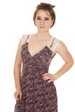 Woman purple dress lace stand serious Royalty Free Stock Image