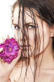 Woman with purple flower Stock Photography
