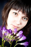 Woman with purple flowers Royalty Free Stock Photography