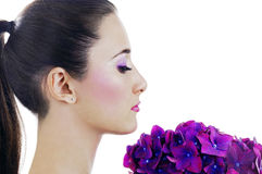Woman with purple flowers Royalty Free Stock Images