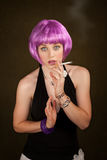 Woman with Purple Hair Caught Smoking Stock Images