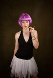 Woman with Purple Hair and Cigar Stock Images
