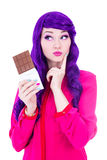 Woman with purple hair holding chocolate and thinking about some. Thing isolated on white background Stock Image