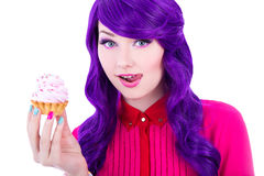 Woman with purple hair holding cupcake with pink cream isolated Stock Images