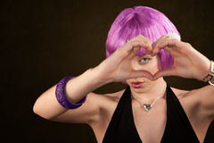 Woman with Purple Hair Making Heart Shape Stock Image