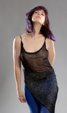 Woman With Purple Hair and Sheer Top. An image of a sexy young woman in a sheer top with sparkly blue bottoms Royalty Free Stock Images