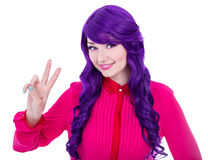 Woman with purple hair showing victory sign isolated on white. Background Stock Image