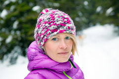 Woman in purple hat and jacket, Karkonosze Mountains, Poland Royalty Free Stock Images