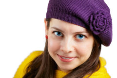 Woman with purple hat and yellow scarf Royalty Free Stock Photos