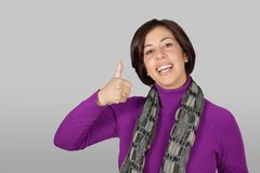 Woman with purple jacket. And gray scarf stock photography