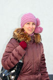A woman in purple jacket and knitted hat Royalty Free Stock Image