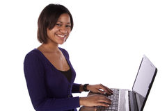 Woman in purple on laptop smiling Royalty Free Stock Photo