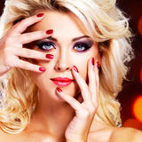 Woman with  purple manicure and makeup of eyes. Royalty Free Stock Photography