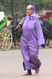 Woman dressed in purple hijab Stock Images