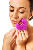 Woman with purple orchid and closed eyes Royalty Free Stock Photo