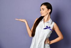 Woman with purple ribbon to world epilepsy day, cancer day poses like she holds something on her open palm and looks at it. Woman with purple ribbon to epilepsy stock photo