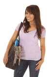 Woman in a purple shirt and bag on arm Royalty Free Stock Photo