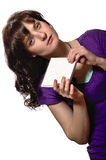 Woman in purple shirt holds blank CD cover Stock Photography