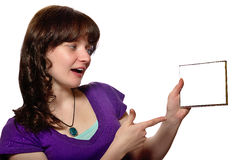 Woman in purple shirt looks to blank CD cover. Woman in purple shirt looks and shows to blank CD cover on white background stock photos