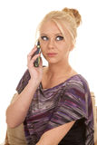 Woman purple shirt phone talk sit look up Stock Photos