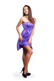 Woman in purple silk waving dress Stock Photos