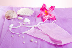 Woman purple spa disposable panties for depilation Royalty Free Stock Photography