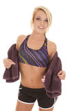 Woman purple sports bra towel around back Stock Images