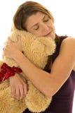 Woman in purple tank hug bear closed eyes Royalty Free Stock Photos