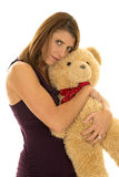 Woman in purple tank hug bear serious Royalty Free Stock Photos