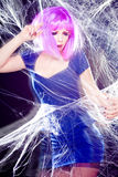Woman with purple wig and intense make-up trapped in a spider web screaming Royalty Free Stock Photo