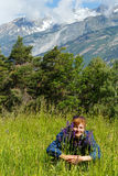 Woman with purple wild flowers (Alps, Switzerland) Royalty Free Stock Photo